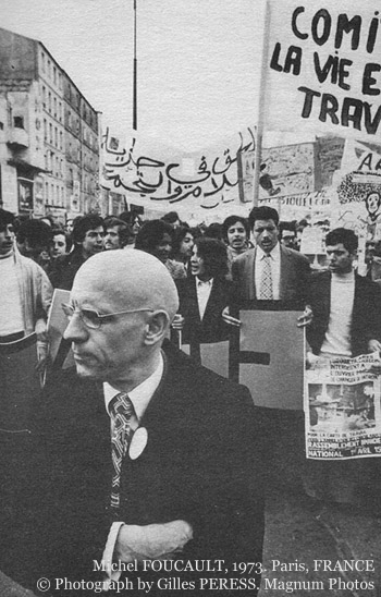 Foucault with immigrants demonstrating, 1973